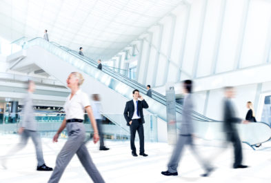 busy people walking through building
